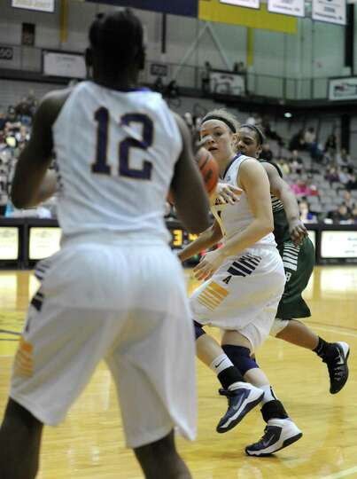 UAlbany's Sarah Royals passes the ball of to Imani Tate during their women's college basketball Amer