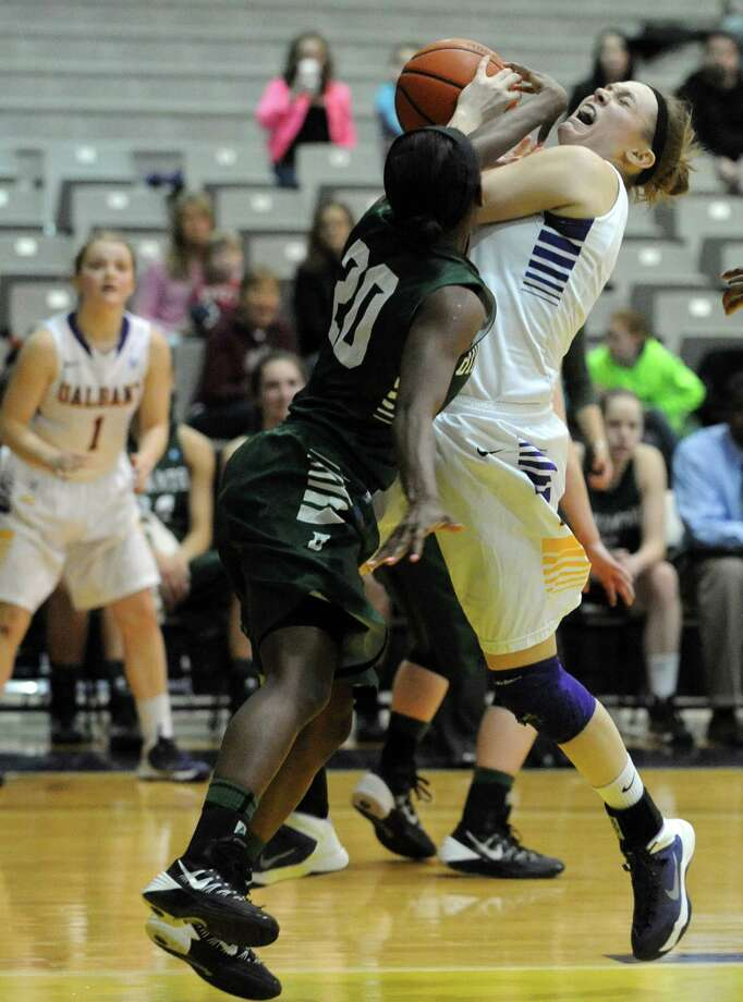 UAlbany's Sarah Royals is fouled going to the basket by Binghamton's Vaneeshia Paulk during their women's college basketball America East game on Wednesday Feb. 19, 2014 in Albany, N.Y. (Michael P. Farrell/Times Union) Photo: Michael P. Farrell / 00025788A