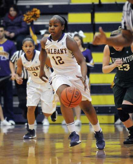 UAlbany's Imani Tate brings the ball up court during their women's college basketball America East g