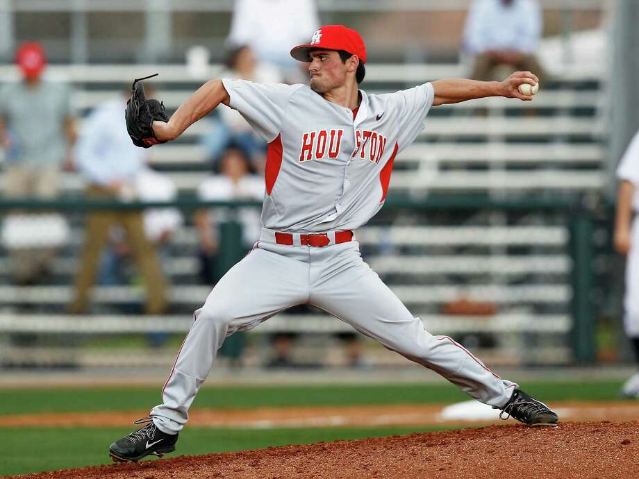 Houston pitcher Matt Locus throws against the Rice Owls during an NCAA baseball game Wednesday, Feb. 19, 2014. Photo: Bob Levey / ©2014 Bob Levey