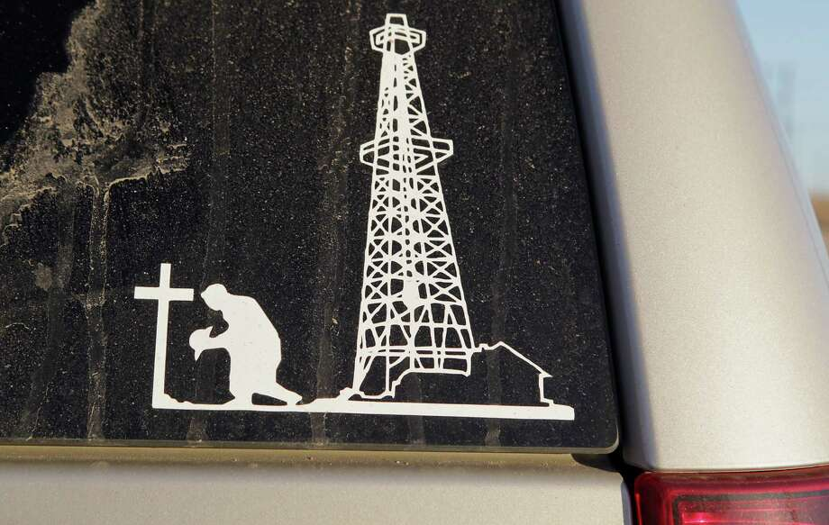 A window decal on the vehicle of Tina Saiz the widow of a Felipe Saiz, Saiz was killed in a drilling rig accident that occurred at Heart Land Drilling Rig 11 in June 2013, holds a locket she wears with some of her late husbands ashes Monday, Feb. 17, 2014, in Big Spring. Photo: James Nielsen, Houston Chronicle / © 2013  Houston Chronicle