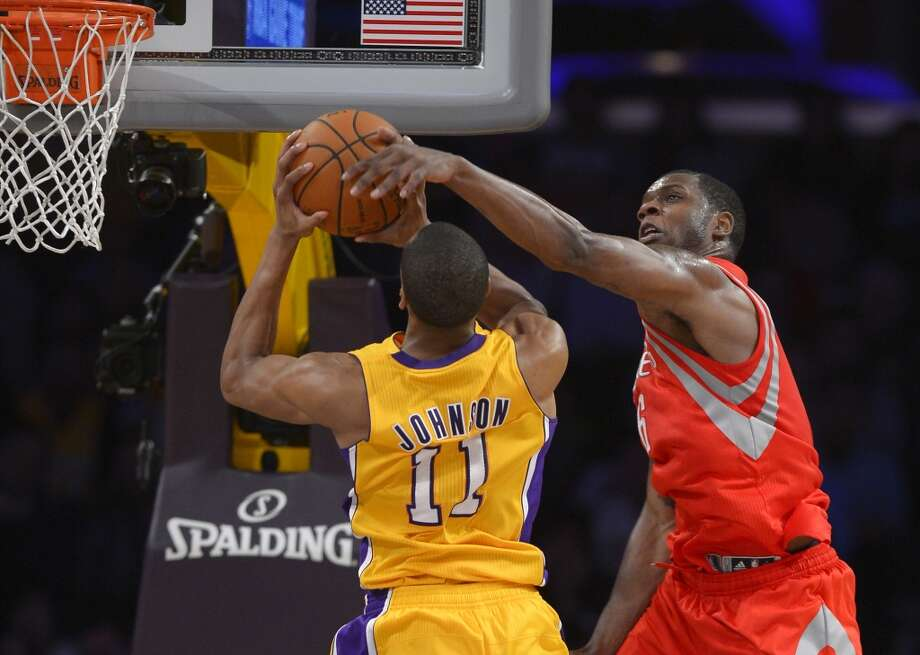 Lakers forward Wesley Johnson, left, goes up for a shot as Rockets forward Terrence Jones defends. Photo: Mark J. Terrill, Associated Press