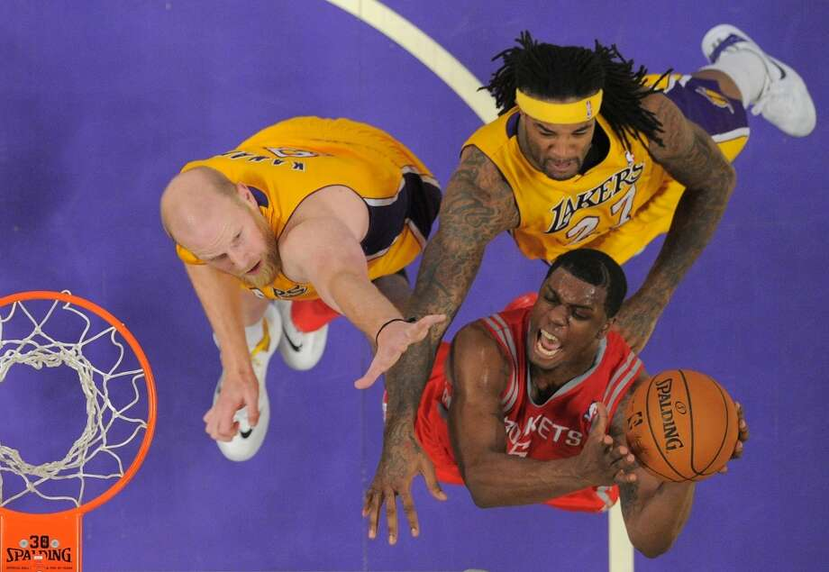 Rockets forward Terrence Jones, lower right, puts up a shot as Lakers forward Jordan Hill, upper right, and center Chris Kaman defend. Photo: Mark J. Terrill, Associated Press