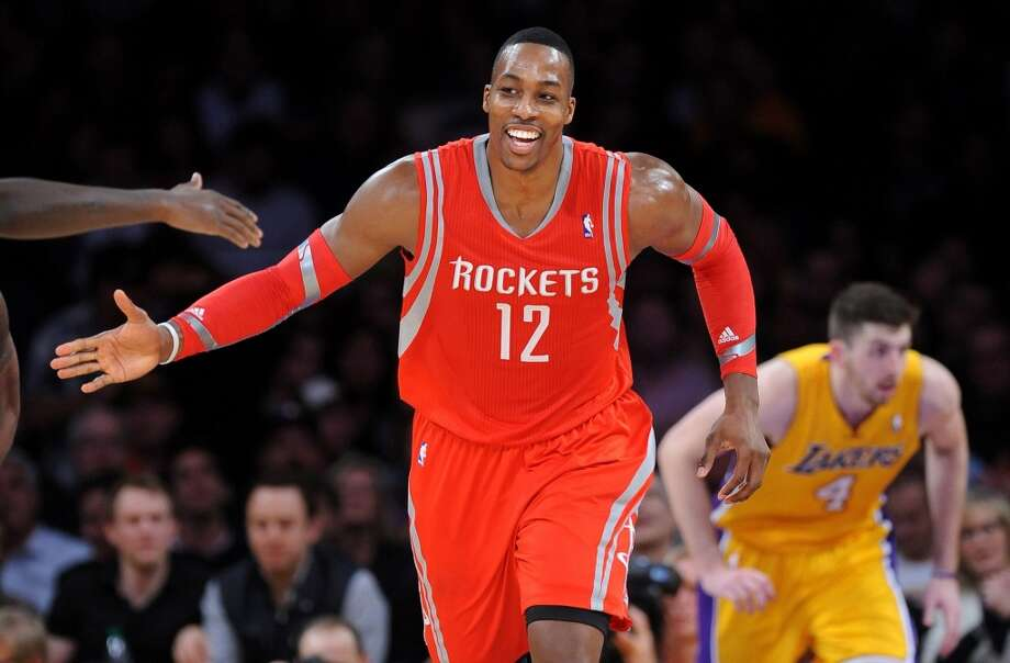 Dwight Howard (12) celebrates his dunk. Photo: Wally Skalij, McClatchy-Tribune News Service
