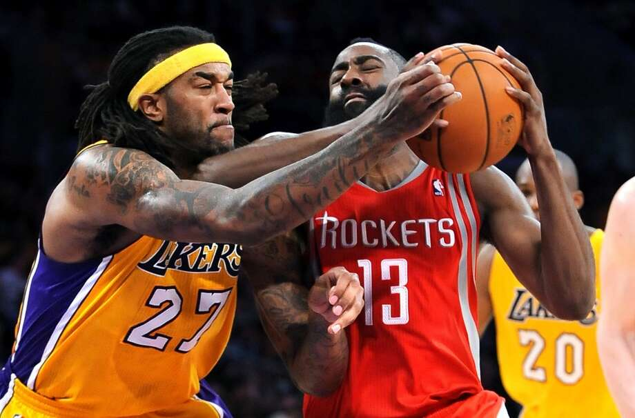 Jordan Hill (27) tries to steal the ball away from the James Harden. Photo: Wally Skalij, McClatchy-Tribune News Service