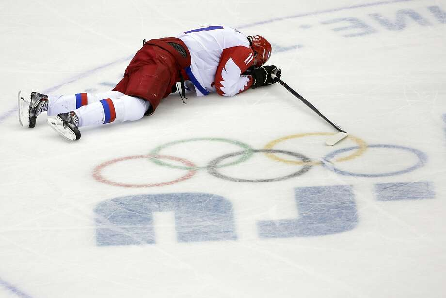 Russia forward Yevgeni Malkin lies on the ice in the closing minutes of the third period in men's quarterfinal hockey game against Finland at Bolshoy Arena at the 2014 Winter Olympics, Wednesday, Feb. 19, 2014, in Sochi, Russia. Finland defeated Russia 3-1. (AP Photo/David J. Phillip ) Photo: David J. Phillip, Associated Press
