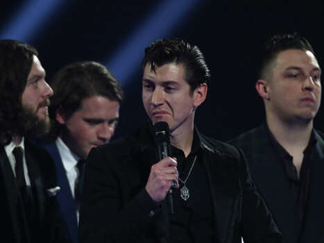 British singer-songwriter Alex Turner is seen on stage with the MasterCard British Album of the Year award, given to his band, the Arctic Monkeys, at the BRIT Awards 2014 at the O2 Arena in London on Wednesday, Feb. 19, 2014. Photo: Joel Ryan, Joel Ryan/Invision/AP / Invision