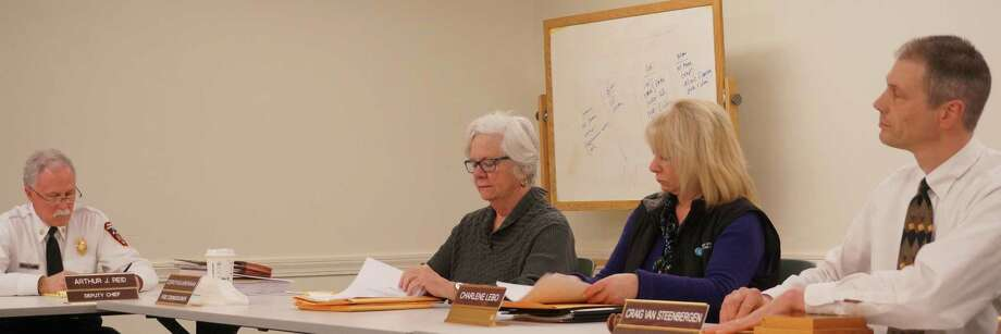 Deputy Fire Chief Art Reid, left, discusses renewal of his contract Wednesday with members of the Fire Commission, from right, Chairman Craig Van Steenbergen, Charlene Lebo and Dorothea Brennan. Photo: Genevieve Reilly / Fairfield Citizen