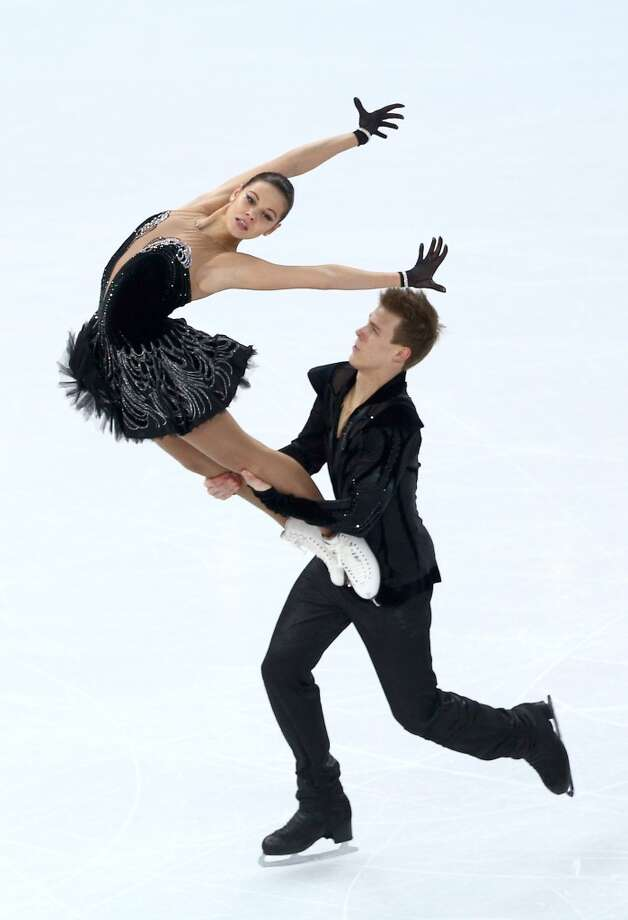 "BEST:  Elena Ilinykh and Nikita Katsalapov of Russia skated to the ""Black Swan,"" and here, theatricality with a black swan costume works. They look sharp and balletic in their ice dancing program in the team competition on Feb. 9. Photo: Clive Mason, Getty Images"