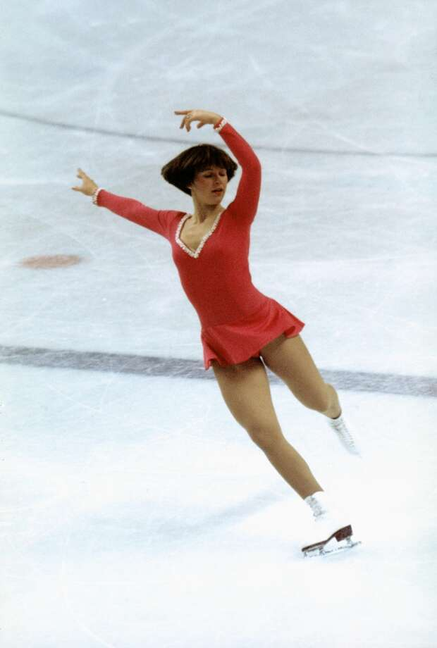 "BEST: American gold medalist   Dorothy Hamill skates in a classic dress with long sleeves in the 1976 Olympics in Innsbruck. This was reportedly the last year that skaters wore homemade outfits, before embracing designer costumes. Hamill's real fashion statement was the hairdo, later known to salons across America as ""the wedge,"" and adopted by millions of women and girls (this writer included) after the televised games. Photo: Tony Duffy, Getty Images"