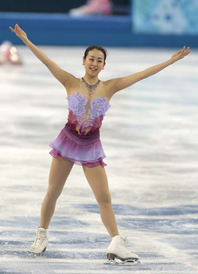 WORST: Love the colors on Mao Asada of Japan in the team skate on Feb. 8, but the neckline's too bare and the floral appliques on the bust should be more delicate, graduating from small to large as they make their way down the torso.  And where is the skirt? Too short. This dress is out of proportion. Photo: Ivan Sekretarev, Associated Press