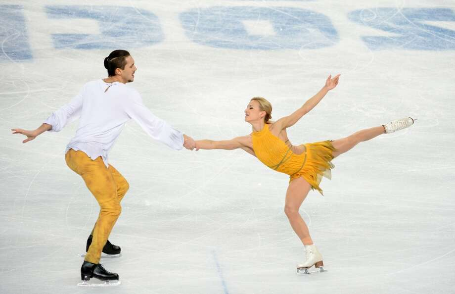 "BEST: Oh God. Literally. Pairs skating gold medalists Tatiana Volosozhar and Maxim Trankov of Russia skate to ""Jesus Christ Superstar"" in outfits that are free of beading and that seem to reflect flowing garb from millenia past. Elegant, proportional and flowing. Photo: JUNG YEON-JE, AFP/Getty Images"