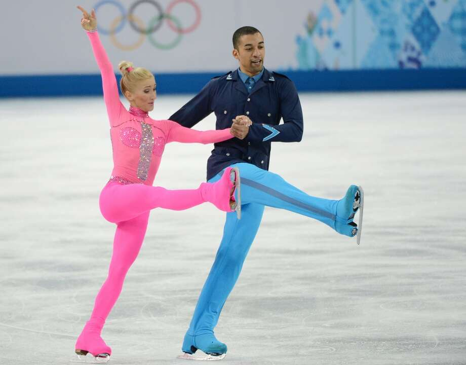 "WORST: Skating to the ""Pink Panther,"" Germany's Aliona Savchenko and Robin Szolkowy took the costuming a bit too literally in the pairs competition Feb. 11. With apologies to the late Peter Sellers, this Pepto Bismol pink unitard and neon blue military jacket combo is as bumbling as Inspector Clouseau. Photo: Chuck Myers, McClatchy-Tribune News Service"