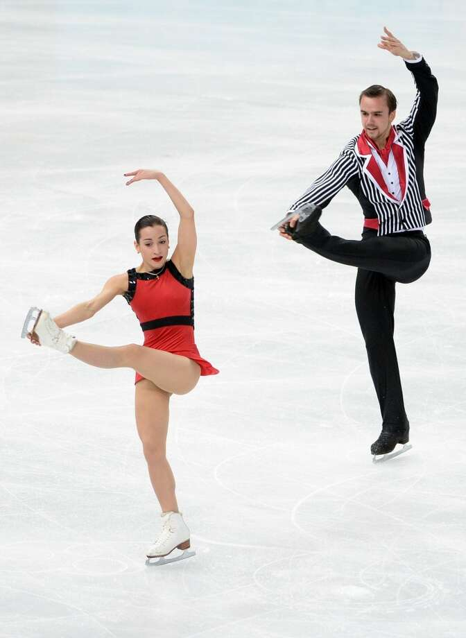 """BEST: Pairs silver medalists Fedor Klimov and Ksenia Stolbova of Russia, who  performed to """"Addams Family"""" music (only a tiny bit contained the finger-snapping TV theme). The look is clean and coordinated, but not overly matchy.  You can almost imagine Fedor kissing Ksenia's arm, like Gomez did to Morticia. Photo: JUNG YEON-JE, AFP/Getty Images"""