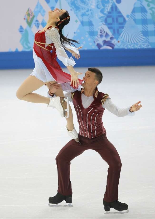 """WORST: These overly dramatic costumes -- campy, actually -- were worn by Charlene Guignard and Marco Fabbri of Italy and belong at the opera, not on the ice, even though they skated to """"Romeo and Juliet."""" Photo: Vadim Ghirda, Associated Press"""