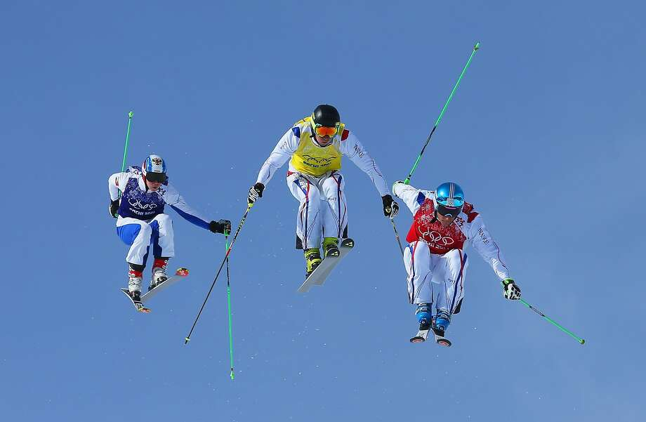 (R-L) JF Chapuis, Jonathan Midol of France and Egor Korotkov of Russia make a jump in the semi final during the Mens Ski Cross Freestyle Skiing at Rosa Khutor Extreme Park on February 20, 2014 in Sochi, Russia.  Photo: Julian Finney, Getty Images