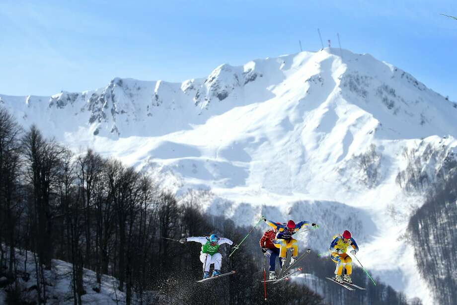 (L-R) John Eklund of Sweden (yellow bib), Michael Forslund of Sweden (blue bib), David Duncan of Canada (red bib) and Arnaud Bovolenta of France (green bib) compete during the Freestyle Skiing Men's Ski Cross 1/8 Finals on day 13 of the 2014 Sochi Winter Olympic at Rosa Khutor Extreme Park on February 20, 2014 in Sochi, Russia.  Photo: Al Bello, Getty Images