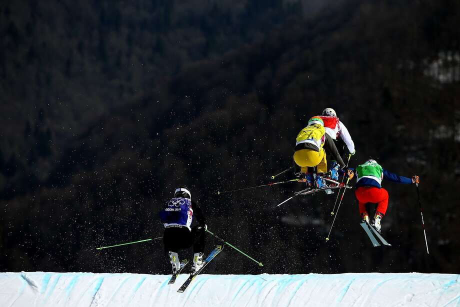 (L-R) Christian Mithassel of Norway (blue bib), Florian Eigler of Germany (yellow bib), Filip Flisgar of Slovenia (red bib) and Tomas Kraus of the Czech Republic (green bib) compete during the Freestyle Skiing Men's Ski Cross 1/8 Finals on day 13 of the 2014 Sochi Winter Olympic at Rosa Khutor Extreme Park on February 20, 2014 in Sochi, Russia.  Photo: Al Bello, Getty Images