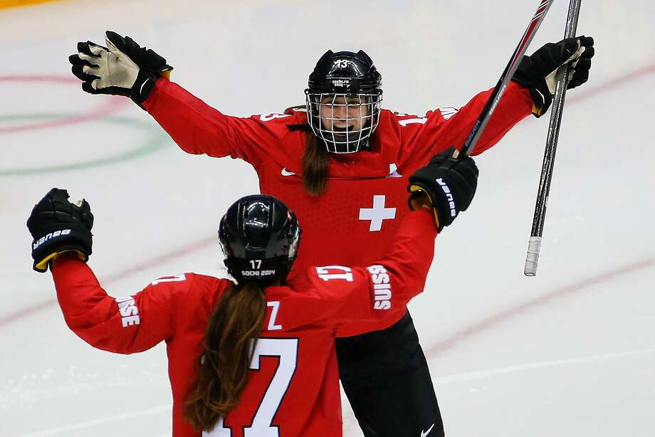 Sara Benz of Switzerland (13) is congratulated by Jessica Lutz of Switzerland (17) after scoring against Sweden in the third period of the women's bronze medal ice hockey game at the 2014 Winter Olympics, Thursday, Feb. 20, 2014, in Sochi, Russia. Photo: Petr David Josek, Associated Press