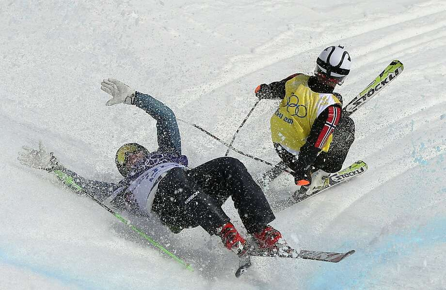 Australia's Scott Kneller, left, and Norway's Thomas Borge Lie crash during a men's ski cross heat at the Rosa Khutor Extreme Park, at the 2014 Winter Olympics, Thursday, Feb. 20, 2014, in Krasnaya Polyana, Russia. Photo: Sergei Grits, Associated Press