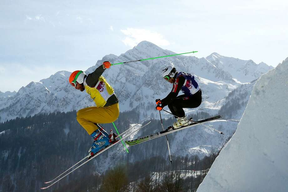 (L-R) Andreas Schauer of Germany (yellow bib) and Didrik Bastian Juell of Norway (blue bib) compete during the Freestyle Skiing Men's Ski Cross 1/8 Finals on day 13 of the 2014 Sochi Winter Olympic at Rosa Khutor Extreme Park on February 20, 2014 in Sochi, Russia. Photo: Cameron Spencer, Getty Images