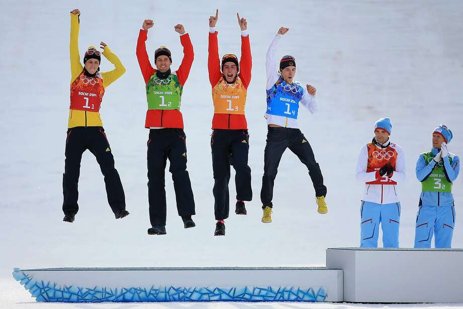 Silver medalists (L-R) Eric Frenzel, Bjoern Kircheisen, Johannes Rydzek and Fabian Riessle of Germany celebrate during the flower ceremony for the  Nordic Combined Men's Team 4 x 5 km during day 13 of the Sochi 2014 Winter Olympics at RusSki Gorki Jumping Center on February 20, 2014 in Sochi, Russia. Photo: Richard Heathcote, Getty Images