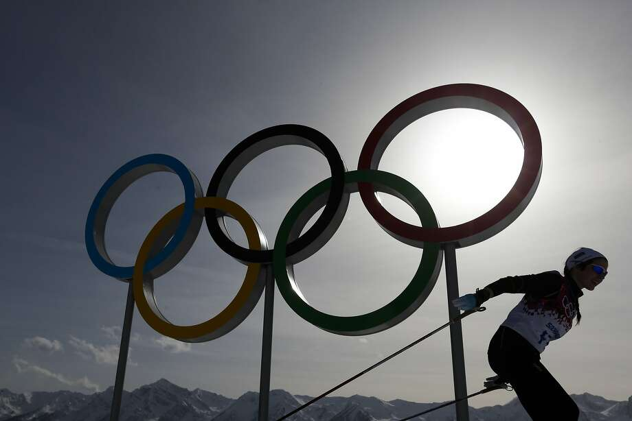 A skier passes by the Olympic rings at the Laura Cross-country Ski & Biathlon Center during a training session at the 2014 Winter Olympics, Thursday, Feb. 20, 2014, in Krasnaya Polyana, Russia.  Photo: Felipe Dana, Associated Press