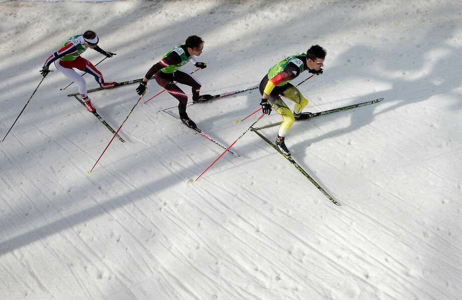 (L-R)  Haavard Klemetsen of Norway, Christoph Bieler of Austria and Bjoern Kircheisen of Germany compete in the Nordic Combined Men's Team 4 x 5 km during day 13 of the Sochi 2014 Winter Olympics at RusSki Gorki Jumping Center on February 20, 2014 in Sochi, Russia.  Photo: Adam Pretty, Getty Images
