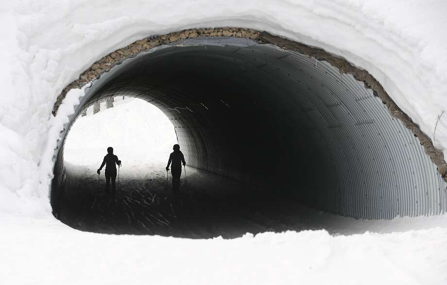 Athletes ski through a tunnel at the Alpine ski venue during training at the Sochi 2014 Winter Olympics, Thursday, Feb. 20, 2014, in Krasnaya Polyana, Russia.  Photo: Christophe Ena, Associated Press