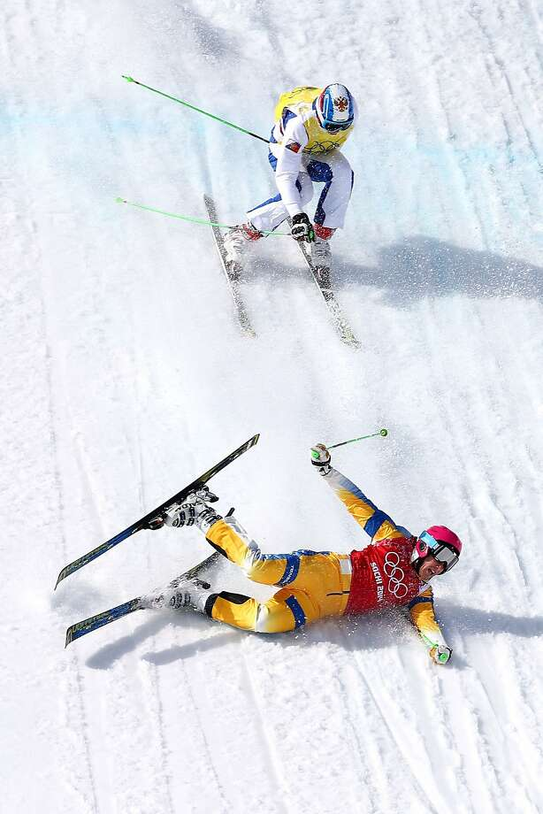Victor Oehling Norberg of Sweden crashes to the snow followed by Egor Korotkov of Russia during the Freestyle Skiing Men's Ski Cross Quarter Finals on day 13 of the 2014 Sochi Winter Olympic at Rosa Khutor Extreme Park on February 20, 2014 in Sochi, Russia. Photo: Streeter Lecka, Getty Images