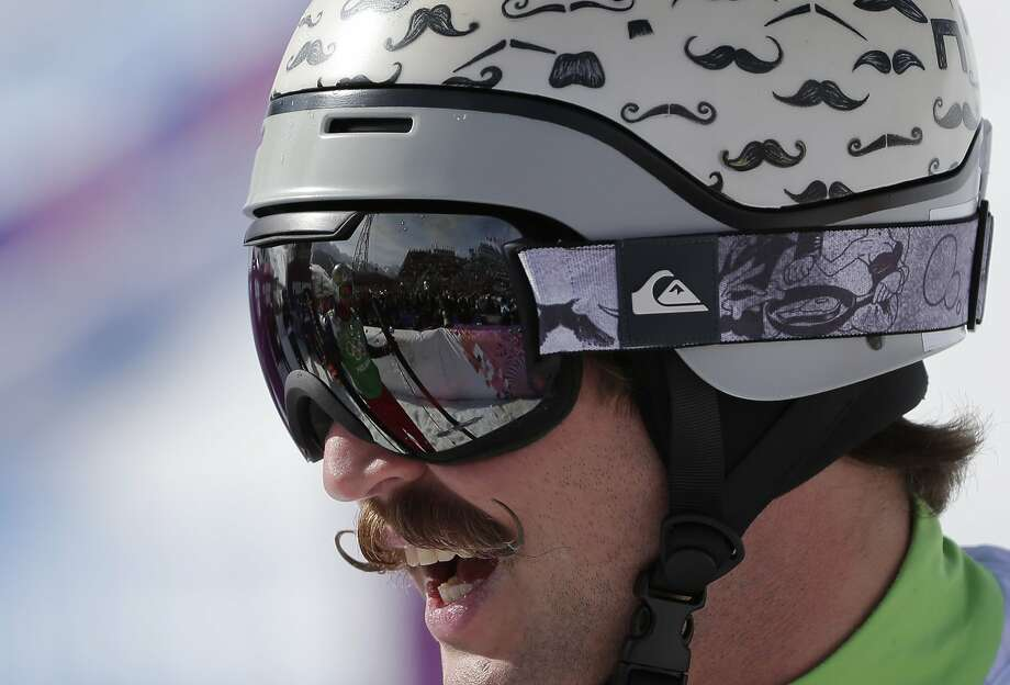 Moustaches are painted on the helmet of Slovenia's Filip Flisar during men's ski cross competition at the Rosa Khutor Extreme Park, at the 2014 Winter Olympics, Thursday, Feb. 20, 2014, in Krasnaya Polyana, Russia.  Photo: Andy Wong, Associated Press