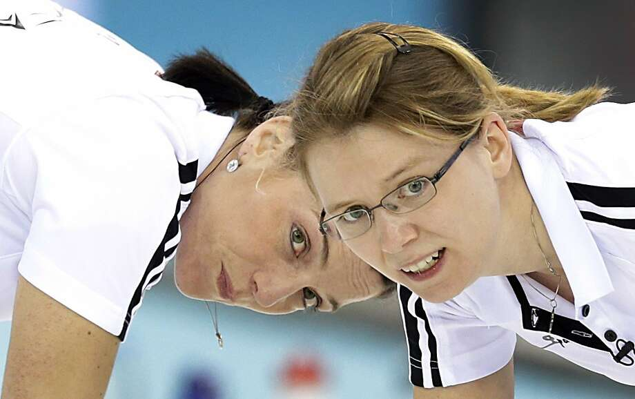 Switzerland's Carmen Kueng, left, and Janine Greiner, right, sweep ahead of the rock during the women's curling bronze medal game against  Britain at the 2014 Winter Olympics, Thursday, Feb. 20, 2014, in Sochi, Russia.  Photo: Wong Maye-E, Associated Press