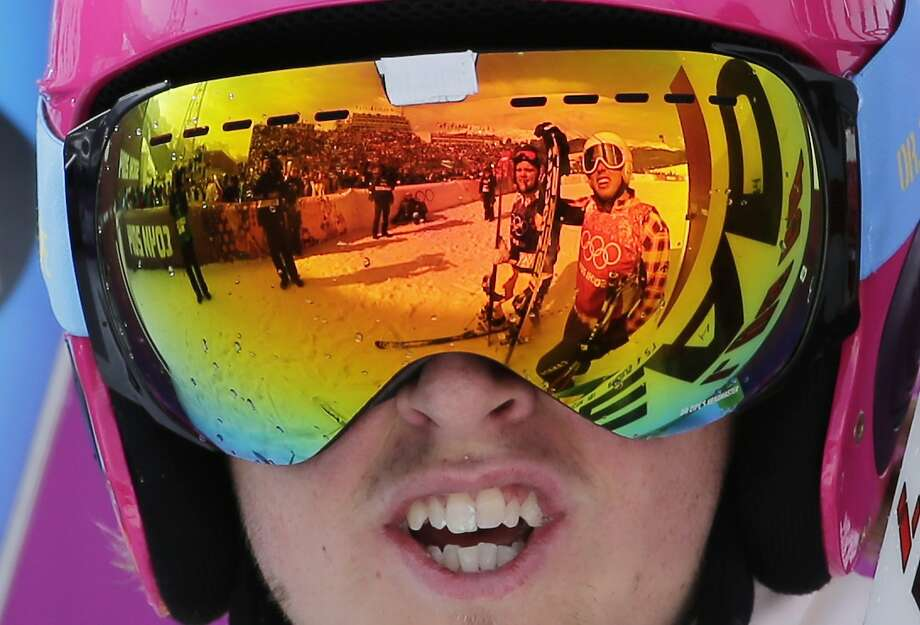 Canada's David Duncan, right, is reflected in the goggles of Sweden's John Eklund after their heat during men's ski cross competition at the Rosa Khutor Extreme Park, at the 2014 Winter Olympics, Thursday, Feb. 20, 2014, in Krasnaya Polyana, Russia. Photo: Andy Wong, Associated Press
