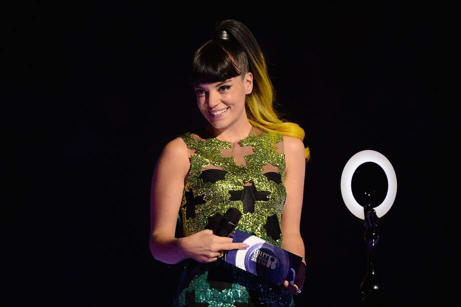 LONDON, ENGLAND - FEBRUARY 19:  Lily Allen presents the award for British Group at The BRIT Awards 2014 at 02 Arena on February 19, 2014 in London, England.  (Photo by Ian Gavan/Getty Images) Photo: Ian Gavan, Getty Images