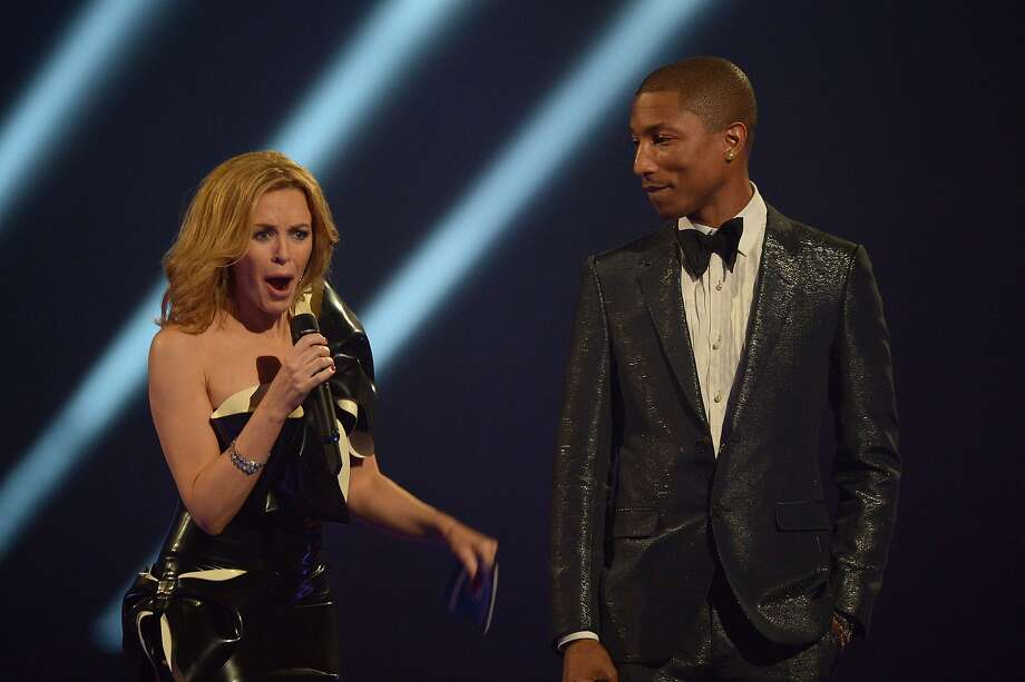 Australian artist Kylie Minogue and US recording artist Pharrell Williams present the British Male Solo Artist award onstage at the BRIT Awards 2014 at the O2 Arena in London on Wednesday, Feb. 19, 2014. (Photo by Jon Furniss/Invision/AP) Photo: Jon Furniss, Associated Press