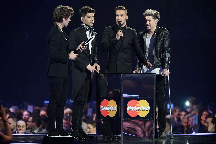 LONDON, ENGLAND - FEBRUARY 19:  Louis Tomlinson, Zayn Malik, Harry Styles, Liam Payne and Niall Horan of One Direction receive the award for Global Success Award at The BRIT Awards 2014 at 02 Arena on February 19, 2014 in London, England.  (Photo by Ian Gavan/Getty Images) Photo: Ian Gavan, Getty Images