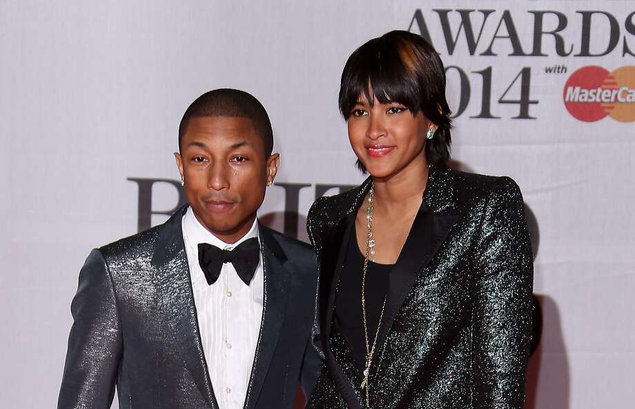 US singer-songwriter Pharrell Williams, left and his wife Helen Lasichanh arrive at the BRIT Awards 2014 at the O2 Arena in London on Wednesday, Feb. 19, 2014. (Photo by Joel Ryan/Invision/AP) Photo: Joel Ryan, Associated Press