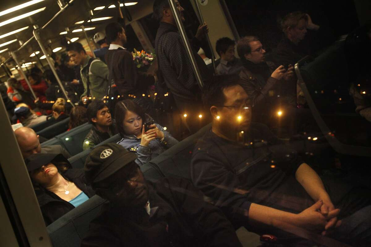 Commuters take the Oakland-bound train through Oakland. Some people have complained that some BART cars are too hot.