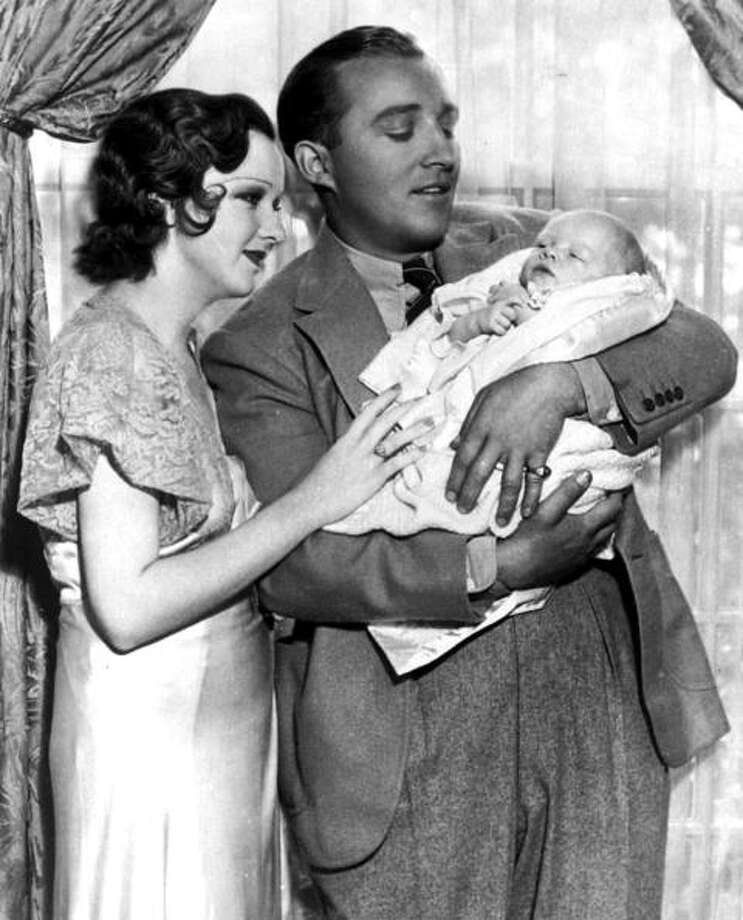 30th July 1933, US singer and film actor Bing Crosby pictured with his wife Dixie and also 3 week old son Gary Evan Crosby at their Hollywood Home  (Photo by Popperfoto/Getty Images) Photo: Popperfoto, Popperfoto/Getty Images / Popperfoto
