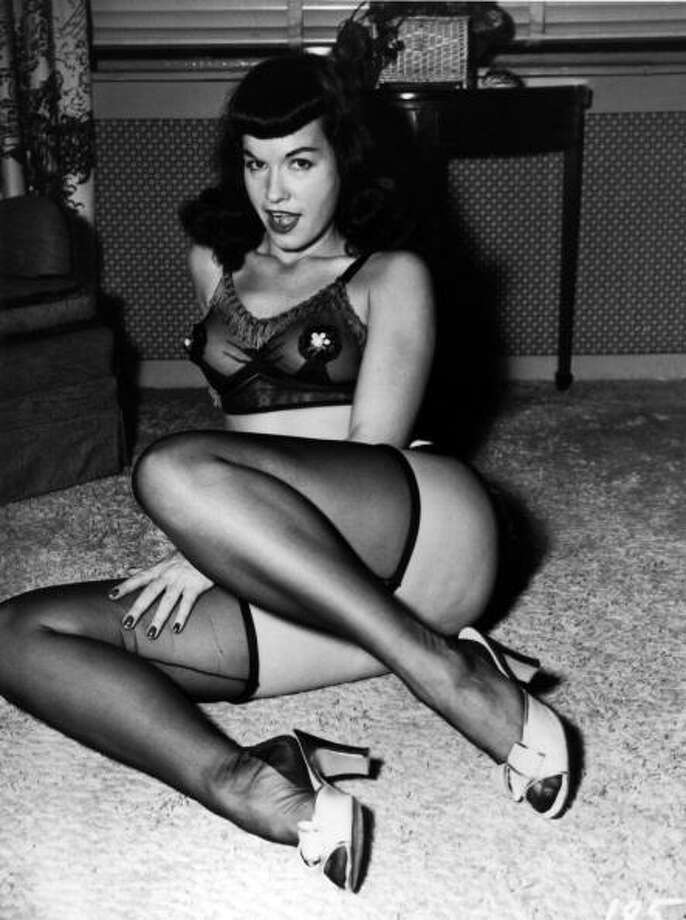 Bettie Page poses for a portrait wearing lingerie circa 1952. (Photo by Michael Ochs Archives/Getty Images) Photo: Michael Ochs Archives / Michael Ochs Archives
