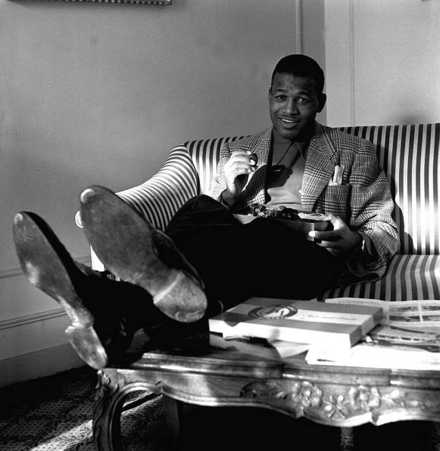 American boxer Sugar Ray Robinson, the World Welterweight boxing champion pictured relaxing in Paris with a box of candy  (Photo by Popperfoto/Getty Images) Photo: Popperfoto, Popperfoto/Getty Images / Popperfoto
