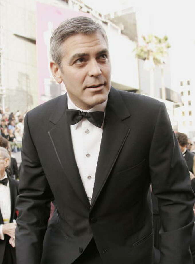 "Actor and director George Clooney arrives 05 March, 2006, for the 78th Academy Awards to be presented at the Kodak Theater in Hollywood, California. Clooney is nominated for Best Supporting Actor for his role in ""Syriana,"" and in the Best Director category for ""Good Night, and Good Luck.""   AFP PHOTO/ROBYN BECK  (Photo credit should read ROBYN BECK/AFP/Getty Images) Photo: ROBYN BECK, AFP/Getty Images / 2006 AFP"