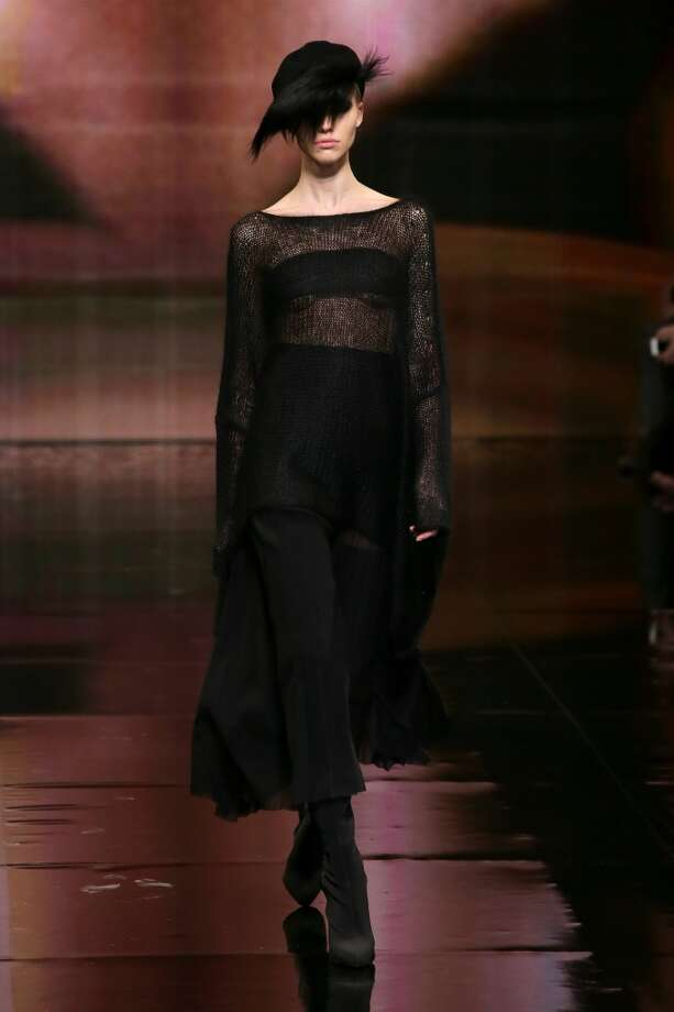 A model walks the runway at the Donna Karan New York 30th Anniversary fashion show. Photo: Neilson Barnard, (Credit Too Long, See Caption)