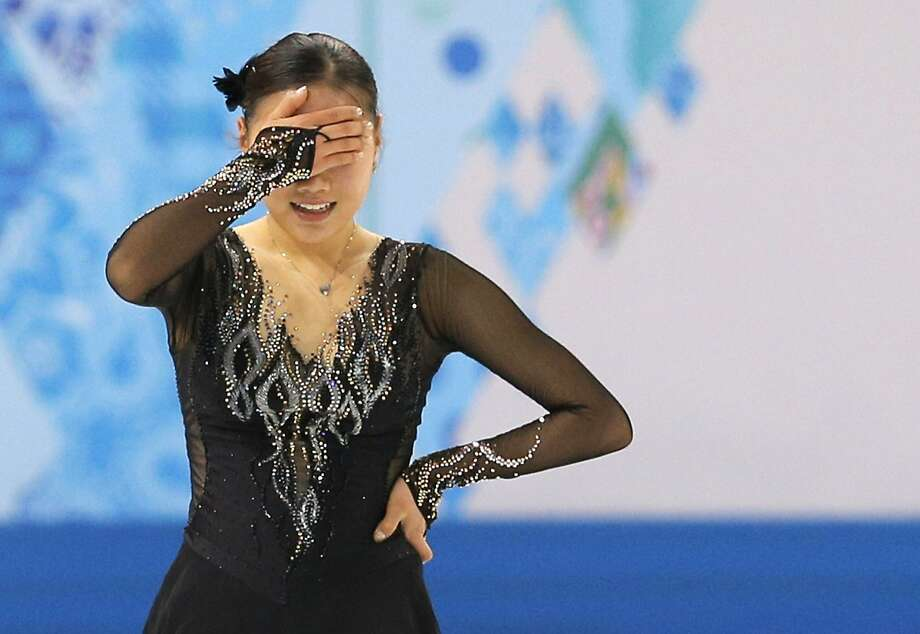 Kim Haejin of South Korea reacts after completing her routine in the women's free skate figure skating finals at the Iceberg Skating Palace during the 2014 Winter Olympics, Thursday, Feb. 20, 2014, in Sochi, Russia. Photo: Vadim Ghirda, Associated Press