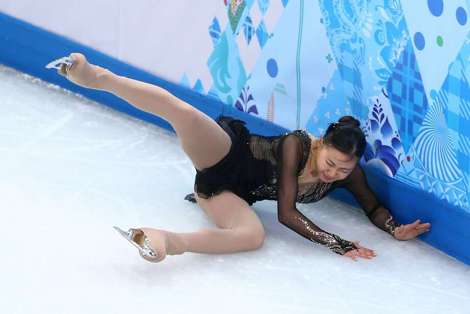 Haejin Kim of South Korea falls while competing in the Figure Skating Ladies' Free Skating on day 13 of the Sochi 2014 Winter Olympics at Iceberg Skating Palace on February 20, 2014 in Sochi, Russia. Photo: Paul Gilham, Getty Images