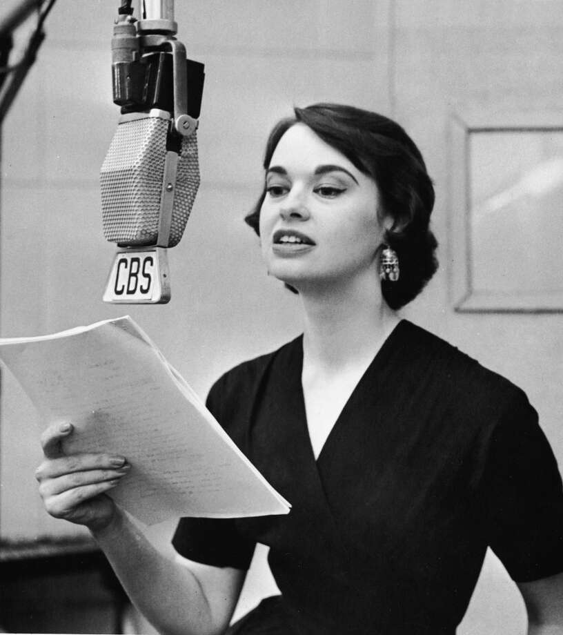 "American heiress and socialite Gloria Vanderbilt discuss her poetry on the CBS Radio program ""The Music Room,"" where three of them, set to music by composer Alan Hovhaness, were performed by opera singer Nell Tangeman under the title ""Canticle for Voice, Strings, and Woodwinds,"" New York, New York, early 1950s. Photo: CBS Photo Archive, Getty Images"