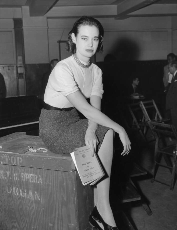 American socialite, fashion designer, actress, writer and artist Gloria Vanderbilt, January 1955. She is holding a copy of the Pulitzer Prize-winning play 'The Time of Your Life' by William Saroyan. Photo: Archive Photos, Getty Images