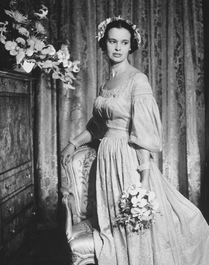 Heiress, poet, actress Gloria Vanderbilt poses in an 1830 beige wedding gown of French linen after exchanging vows with her third husband, movie director Sidney Lumet in 1956. Photo: Gordon Parks, Time & Life Pictures/Getty Image