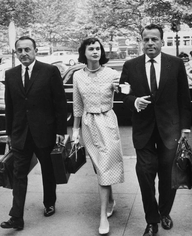 American heiress and socialite Gloria Vanderbilt walks with her attorneys on the way to a custody hearing with her former husband, Leopold Stokowski, June 5, 1959. Vanderbilt was married to Stokowski from  1945-1955; the relationship didn't last long, but it produced two sons. Photo: Hulton Archive, Getty Images