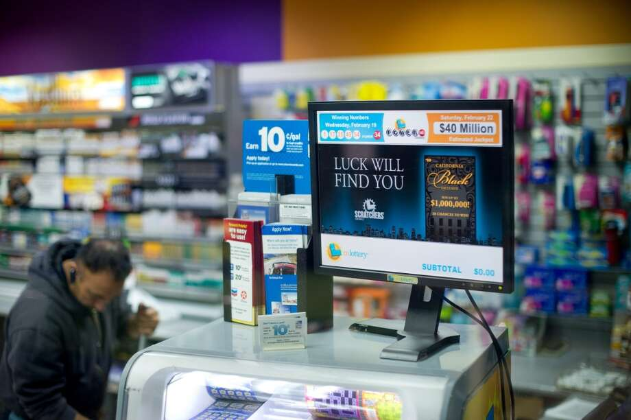 A screen displays winning Powerball numbers at Dixon Landing Chevron while a night worker cleans up the convenience store in Milpitas. According to California lottery officials, the store sold the lone winning ticket for a $425 million Powerball jackpot but there was no immediate word on who may have won one of the largest lottery jackpots in U.S. history. Photo: Noah Berger, Associated Press